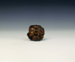 Wooden netsuke of seven Noh masks by Koyosai