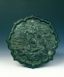 Bronze mirror with two fighting horsemen
