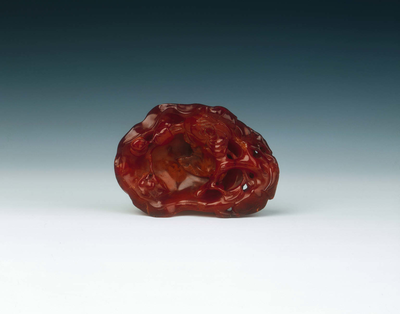 Amber brushwasher carved as a floral group