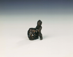 Bronze group of boy with openwork barrel garden