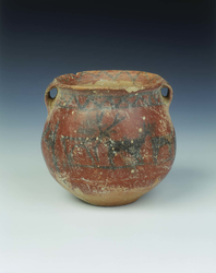 Ochre red slipped pottery jar with deer and